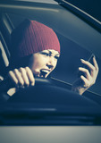 Angry woman shouting on cell phone in her car