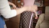 designer takes measurements measuring tape dress before tailoring for girls