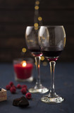 Festive glass of wine with chocolate candies