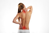 Tired woman massaging back and neck muscles. Health care and medicine.  - 137315392