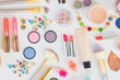 Colorful make up and brushes products flat lay pattern on white background