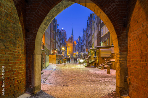 Gate to the Mariacka street in Gdansk at snowy night, Poland