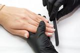 Woman doing manicure beauty salon