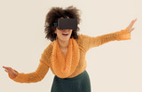 Woman with virtual reality glasses playing the game
