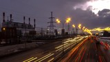 time lapse video of night traffic on urban thoroughfare along industrial zone