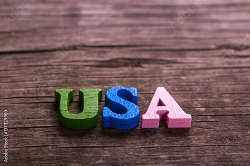 usa word made from colored wooden letters on an old table Poster