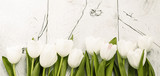 White tulips on wooden background