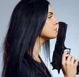 Gothic girl with gun
