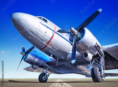 Fototapeta historic airplane on a runway