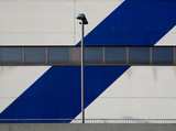 Blue and white building with a street lamp - 137371181