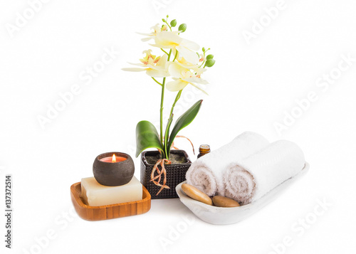 Papiers peints Spa Spa set isolated .Orchid flower with towels, soap and candle burning on white background
