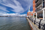 Gunwharf Quays is a former military facility in Portsmouth, UK which is now converted in to luxury homes and apartments, as shown. Portsmouth Harbour is to the left.