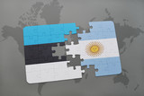 puzzle with the national flag of estonia and argentina on a world map