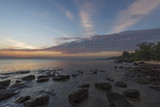 Sunset on the beach .