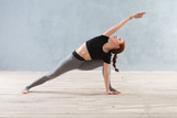 Young woman practicing yoga in a urban background. A series of yoga poses. Fitness, sport, yoga - concept.