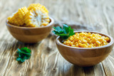 Canned sweet corn in a wooden bowl.