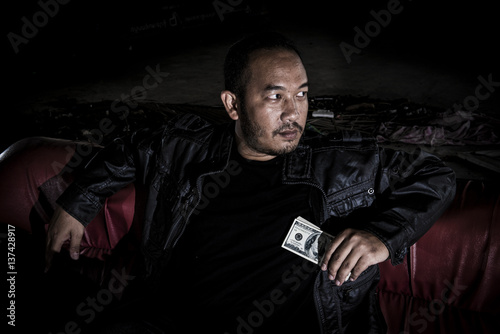 The image of a man who looks like a mafia, drug dealers who have money in hand Poster