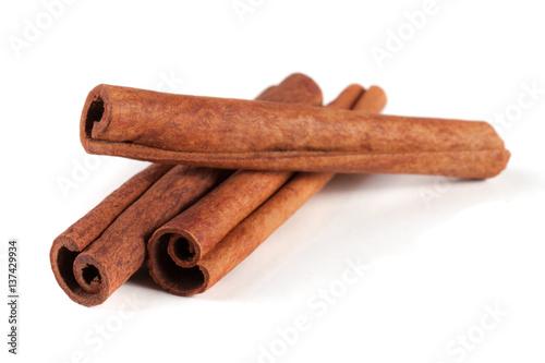 three cinnamon sticks isolated on white background