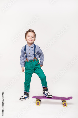 Young skater kid boy isolated on white Poster
