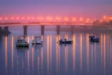 Reflections in Plentzia bridge on foggy night