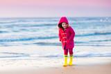 Fototapety Child on North Sea beach in winter