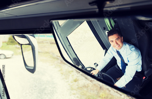 close up of driver reflection in bus mirror