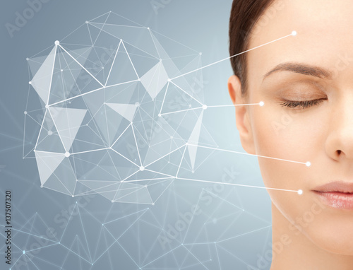 beautiful woman half face with low poly projection