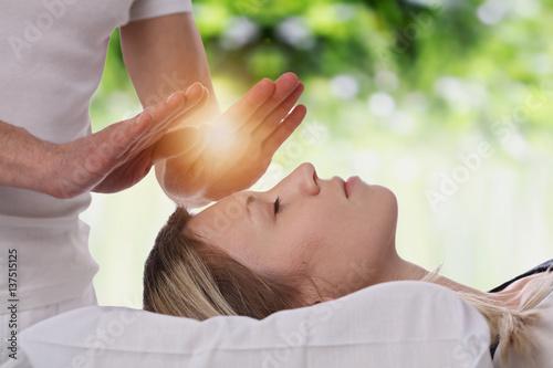 Leinwanddruck Bild Woman having reiki healing treatment , alternative medicine concept.