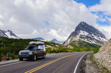 SUV on road by Glacier National Park