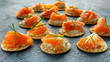 Smoked Salmon and soft chees canapes appetizers with chives on stone table