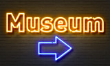 Museum neon sign on brick wall background.