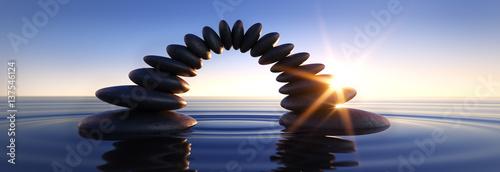 Leinwanddruck Bild Steinbrücke im Meer bei Sonnenuntergang