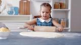 Little girls rolled pizza dough