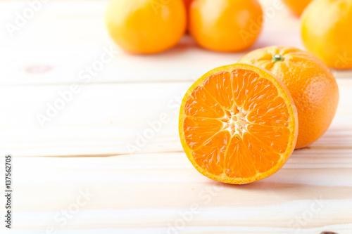 Fresh oranges cut on wooden background © azonman