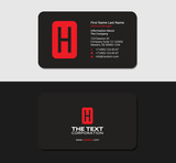 black business cards with the red letter H, stationery