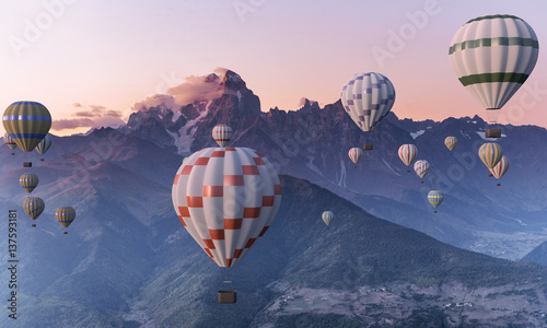 Colorful hot-air balloons flying over the mountain.