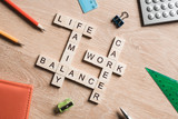 Words work life balance and family on table collected with wooden cubes - 137609181