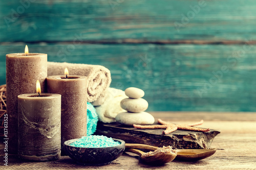Staande foto Spa Set for spa treatments with cosmetic products for body care and relaxation on wooden background with space for a text