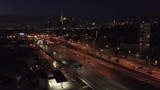 night flying backward alongside highway with New York City in background
