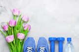Fototapety Spring flatlay composition with sport equipment and tulips.