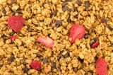 Dry strawberries and cereals close up