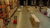 Panorama shot of a warehouse with automated guided vehicles