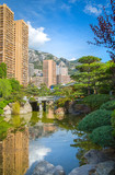 Jardin Japonais, Japanese Garden view with residential buildings at the background. Monaco, Monte Carlo