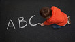 Cute Boy, with Chalk on Street/Tarmac, Learning his ABC