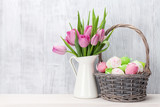 Easter eggs and pink tulips bouquet