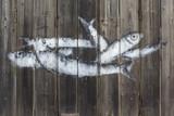 Fische, auf eine Holzwand eines Fischmarktes gemalt, Livorno, Toskana, Italien