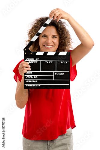 Happy mature woman holding a clapboard Poster