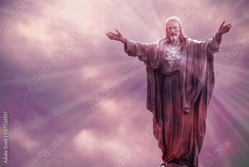 Jesus Christ statue against beautiful sky background Poster