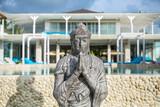 Buddha statue on hotel background