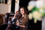 Beautiful woman drinking champagne in a restaurant